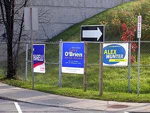 Ottawa municipal election, 2006 - Campaign signs posted at the corner of Metcalfe Street and Catherine Street for leading mayoral candidates Bob Chiarelli, Larry O'Brien and Alex Munter.