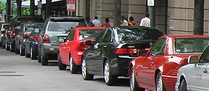 Cars parallel parked along K Street in Washing...