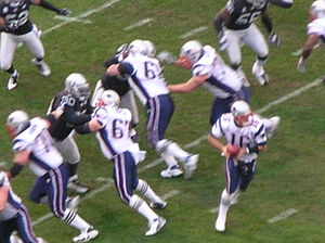 The New England Patriots on offense during an ...