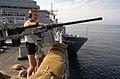 Persian Gulf. A yeoman stands lookout watch next to an M2 .50-caliber machine gun aboard the dock landing ship USS MOUNT VERNON (LSD 39) - DPLA - c70171547f9ff60c2684a29a11313d05.jpeg