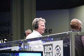 Phil Simms - Simms (center) during a CBS broadcast in 2019