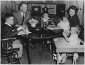 Photograph of Representative Gerald R. Ford, Jr., with Betty Ford and Their Children, Sitting at the Dining Room... - NARA - 187004.tif