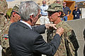 Pinning on a combat action badge 111029-A-QO451-002.jpg
