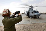 Plane Captain Helps UH-1Y Huey Get Off Ground DVIDS269588.jpg