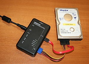 Digital forensics - A portable Tableau write-blocker attached to a hard drive