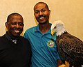 Posing for picture with Bald Eagle. (10595288505).jpg