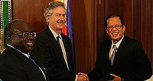 Presidency of Benigno Aquino III - US Under Secretary of State for Political Affairs William Joseph Burns (middle) shakes hands with President Benigno S. Aquino III (right) as United States Ambassador to the Philippines Harry K. Thomas, Jr. (left) looks on.