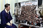 "President Reagan looking at ""Get Well Soon Mr. President"" - C1497-5A.jpg"