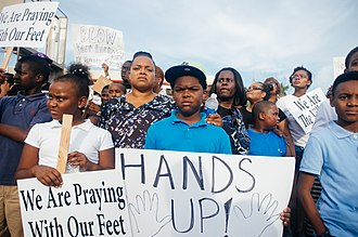 """Hands up, don't shoot - """"Hands up!"""" sign at a protest in Ferguson, Missouri in August 2014"""