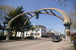 Federal Hill, Providence, Rhode Island - Gateway arch over Atwells Avenue. La Pigna sculpture, a traditional symbol of welcome, abundance and quality, hangs from the center.