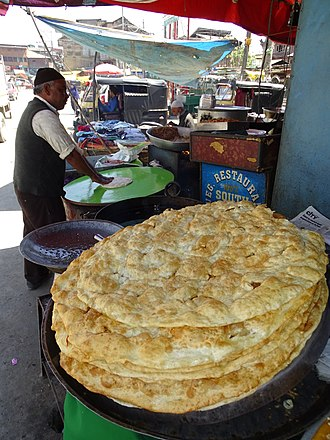 Kashmiri cuisine - Image: Puris (Kashmiri Fried Bread) with Vendor Old City Srinagar Jammu & Kashmir India (26564862530)