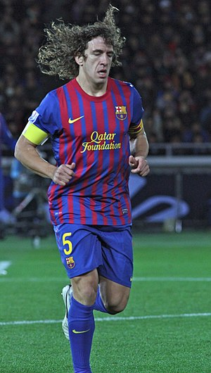 Carles Puyol - Puyol playing for Barcelona in 2011