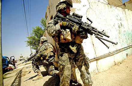 U.S. soldiers from the 6th Infantry Regiment taking up positions on a street corner during a foot patrol in Ramadi, Iraq Ramadi august 2006 patrol.jpg