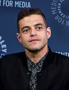 Rami Malek won for his portrayal of Freddie Mercury in Bohemian Rhapsody (2018); the first Arab to win the award. Rami Malek in 2015 (2) (cropped).jpg