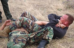 Staff Sgt. Roark demonstrates armbar
