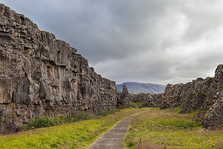 Lögberg (icelandic for Law Rock), Þingvellir National Park, Southern Region, Iceland. The Lögberg was the place on which the Lawspeaker (lögsögumaður) took his seat as the presiding official of the assembly of the Althing, the national parliament, from 930 until 1262 (when Iceland took allegiance to Norway). Speeches and announcements were made from the spot and anyone attending could make their argument from the Lögberg.