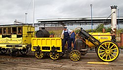 Antique yellow locomotive with engineer