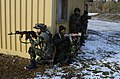 Romanian soldiers role-playing as Afghan National Army soldiers provide security during a mission rehearsal exercise at the Joint Multinational Readiness Center in Hohenfels, Germany, March 19, 2013 130319-A-OY175-002.jpg