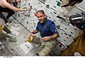 S125-E-006611 - John Grunsfeld and Gregory C. Johnson work with lithium hydroxide canisters on Atlantis during STS-125.jpg