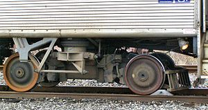 Budd Silverliner - Side view of the Budd Pioneer III truck on Silverliner II No. 9009 showing the suspension elements and cowcatcher applied to the Reading cars.