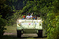 STS-135 Sandy Magnus drives the M113 personnel carrier.jpg