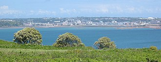 Caroline LeSueur - Saint Helier viewed across St Aubin's Bay from the west