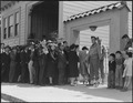 San Francisco, California. Japanese family heads and persond living alone, form a line outside Civi . . . - NARA - 536422.tif
