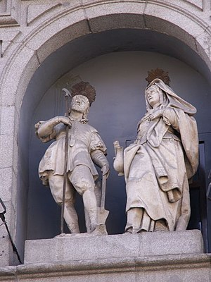 Maria Torribia - Statues of St. Isidore and St. Maria Torribia (María de la Cabeza) on the facade of the Colegiata de San Isidro in Madrid.