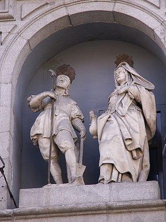 Maria Torribia - Statues of St. Isidore and St. Maria Torribia (María de la Cabeza) on the facade of the Colegiata de San Isidro in Madrid.