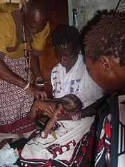 Sangoma performing a Baptism