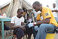 Scientology Volunteer Ministers doing medical work in Haiti 2010.jpg