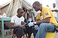 Scientology Volunteer Ministers doing medical work in Haiti 2010.jpg
