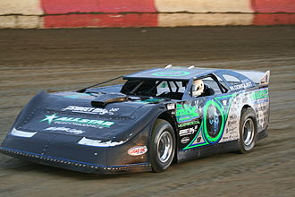 Stock car racing - A late model car on a dirt track