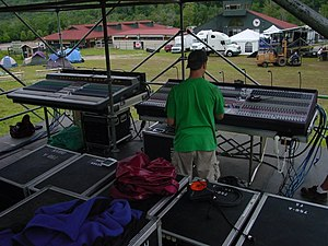 Live sound mixing - Two FOH consoles at an outdoor event.