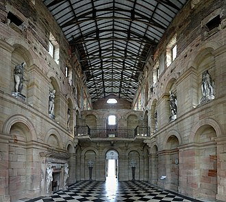 Seaton Delaval Hall - The inside of the central block's main entrance. The stucco statues at first-floor level are permanently affixed to the walls; the missing ceiling was destroyed in the fire of 1822. The roof is modern.