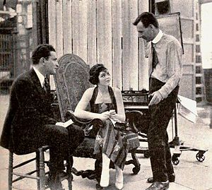 Alan Crosland - Alan Crosland (standing) telling stories to Myron Selznick and Elaine Hammerstein, 1919
