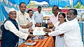"Shri Manikrao Gavit giving the certificate to NRHM people who participated in ""Bharat Nirman Lok Mahiti Abhiyan"", at Shahada, District Nandurbar, Maharashtra on April 22, 2011.jpg"