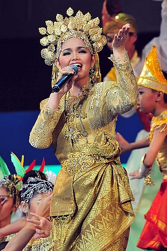 Malayisation - Siti Nurhaliza, the most prominent Malay pop star of her era, performing in full traditional Malay costume. She is credited with having introduced and popularised the Malay traditional pop culture throughout the Malay world.