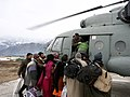 Snow trapped civilians of Nawapachi area of Kishtwar region going for air lift by MI-17 helicopter. IAF's Jammu based 130 helicopter unit launched massive rescue relief operation in snow covered remotest part of Kishtwar.jpg