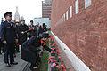 Soyuz TMA-15M crew member Samantha Cristoforetti lays flowers at the Kremlin Wall.jpg