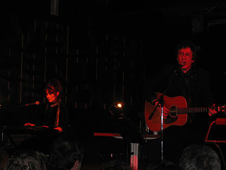 Stan Ridgway - Stan Ridgway (r) performing with Pietra Wexstun (l) in 2005