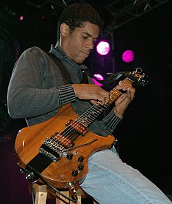 Stanley Jordan plays guitar.