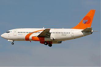 Starline.kz - A Starline Boeing 737-200 approaches Dubai International Airport in 2008.