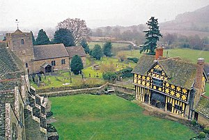 Stokesay Castle - The courtyard, with the 13th-century south tower and solar block (l), the church (c) and the 17th-century wood and plaster gatehouse (r)
