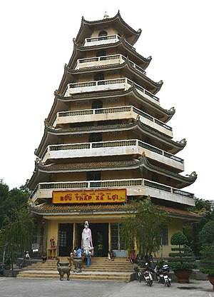Giác Lâm Pagoda - A statue of Quan Am stands at the entrance to the seven-storied stupa.
