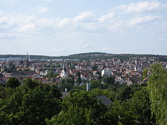 "Zuffenhausen - View from the southeast (gardens on the lower slopes of Burgholzhof) of the core area of the modern city district of Zuffenhausen. The towers of St. Paul (left) and St. John's Church in the ""Old Patch"" (right) are visible."