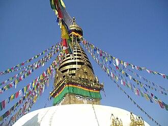 Buddhism in Nepal - Swayambhu stupa and prayer flags.