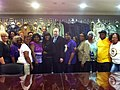 Terri Sewell with Union representatives from American Apparel in Selma, Alabama.jpg