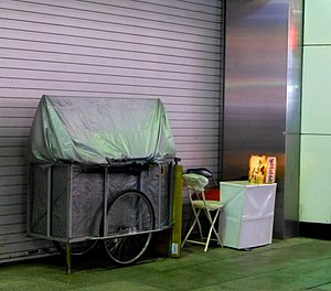 Palmistry - A palm-reader's booth setup outside in Japan.