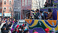 The 2013 Krewe of Harambee MLK Day Mardi Gras Parade Thowing beads.jpg